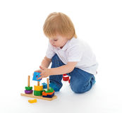 Little boy in the classroom at Montessori environment. Royalty Free Stock Photos