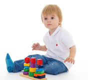 Little boy in the classroom at Montessori environment. Royalty Free Stock Images