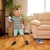 Little boy cleaning the apartment, washing the floor Stock Images