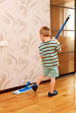 Little boy cleaning apartment, washing floor Royalty Free Stock Photo