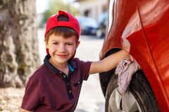 Little boy cleaning car Stock Photo