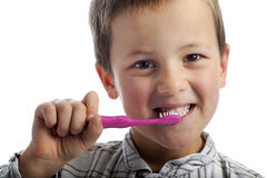 Little boy cleaning his teeth Stock Photos
