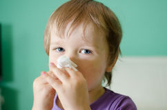 Little boy cleaning nose Stock Photos