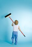 Little boy with cleaning swab over blue Royalty Free Stock Images