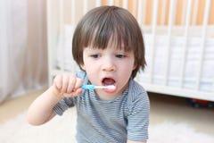 Little boy cleans teeth Stock Photos