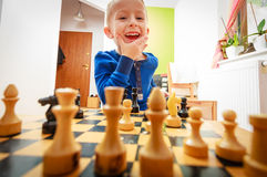 Little boy clever child playing chess thinking, Royalty Free Stock Images