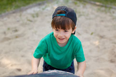 Little boy climb on playground Royalty Free Stock Photo