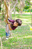 Little boy climb on a tree robe. In the park Royalty Free Stock Photo