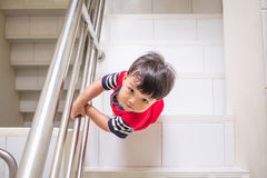 Little boy climb up the stairs from directly above royalty free stock photography