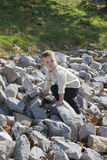 Boy climbing on rocks Royalty Free Stock Photography