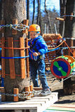 Little boy climbing in adventure activity park Royalty Free Stock Images