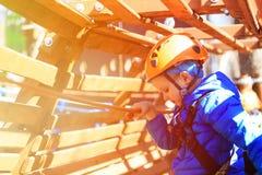 Little boy climbing in adventure activity park Stock Images