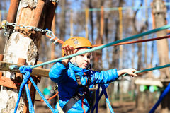 Little boy climbing in adventure activity park Stock Photography