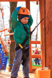 Little boy climbing in adventure park Stock Images