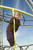 Little boy on a climbing frame Stock Images