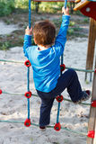 Little boy climbing without helmet Royalty Free Stock Photos