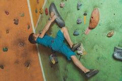Little boy climbing indoor Stock Photos