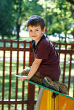 Little boy climbing on jungle gym Stock Images