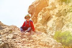 Little boy climbing in mountains Stock Photography
