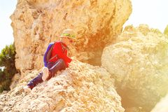 Little boy climbing in mountains Stock Images
