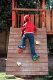 Little boy climbing Stock Photo