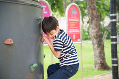 Little boy climbing  at playground in the park Royalty Free Stock Images
