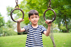 Little boy climbing  at playground in the park Stock Photography