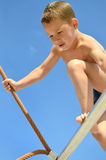 Little boy on the climbing rope royalty free stock photography