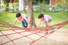 Little boy climbing on the rope playground Stock Photography