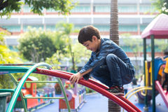 Little boy climbing on the rope at playground outdoor stock image