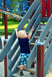 Little boy climbing steps at the playground Royalty Free Stock Photos