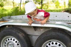 Little Boy Climbing Trailer  Royalty Free Stock Image