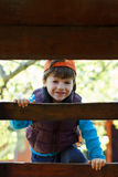 Little boy climbing up on ladder Stock Images