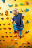 Little boy on the climbing wall Royalty Free Stock Image