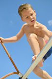 Little boy climbs on the jungle gym Royalty Free Stock Photography