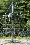 Little boy climbs the ropes Stock Photography