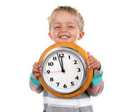 Little boy with clock. Smiling nursery school child holding a clock Royalty Free Stock Photos