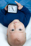 Little boy with a clock Royalty Free Stock Images
