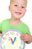 Little boy with a clock Royalty Free Stock Photography