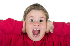 Little boy closes ears. On a white background Royalty Free Stock Images