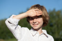 Little boy closes his hand from the sun Royalty Free Stock Photo
