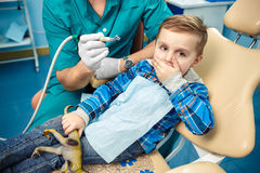 A little boy closes a mouth a palm Royalty Free Stock Photos
