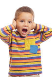 Little boy closing ears with his hands Royalty Free Stock Image