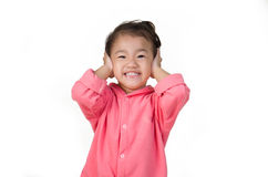 Little boy closing ears with his hands, isolated. Stock Photos