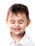 Little boy with closing eyes Stock Photos