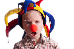 A little boy with a clown nose clown in a hat. On a white background Stock Image