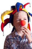 A little boy with a clown nose clown in a hat. On a white background Royalty Free Stock Photos