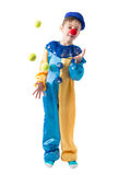 Little boy in clown suit juggling three balls and smiling. On a white background Stock Images