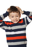 Little boy clutched at his head. Stock Photos