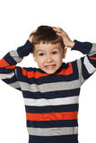 Little boy clutched at his head. Stock Photo